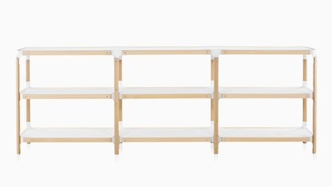 A Magis Steelwood modular shelving system with three rows of white shelves and a wood frame.
