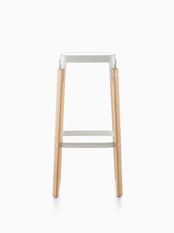Magis Steelwood Stool with a white steel seat and wood legs in a light finish.