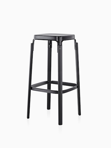 Magis Steelwood Stool with a black steel seat and black wood legs, viewed from an angle.