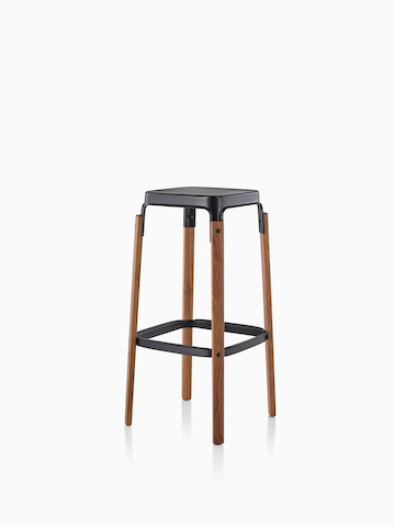 Magis Steelwood Stool with a black steel seat and wood legs. Select to go to the Magis Steelwood Stool product page.