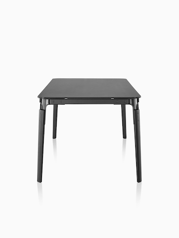 A rectangular Magis Steelwood Table with a black top and legs, viewed from the narrow end.