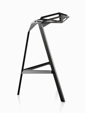 Profile view of a black Magis Stool_One stackable stool.