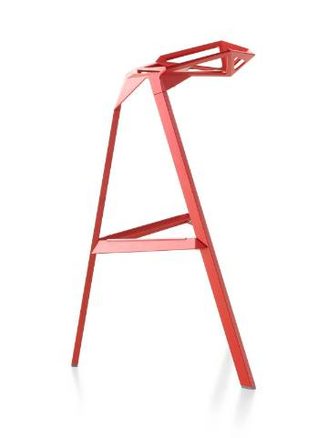Profile view of a red Magis Stool_One stackable stool.