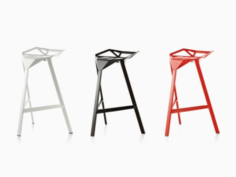 White, black, and red Magis Stool_One stackable stools lined up in a row.