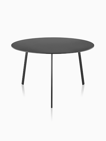 A round Magis Striped Tavolo table with a low profile and black top.