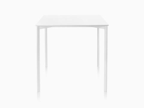 A white Magis Striped Tavolo table with a square top.