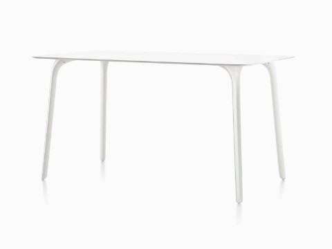 An angled view of a white Magis Table First table with a rectangular top.