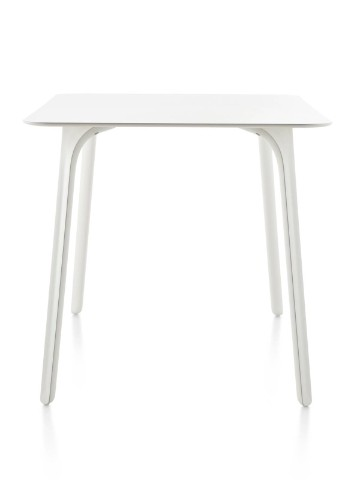 A white Magis Table First table with a square top.
