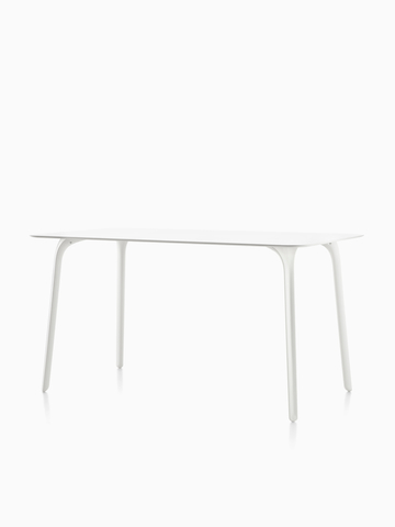 Una mesa rectangular Magis Table First con una tapa blanca. Seleccione para ir a la página Magis Table First product.