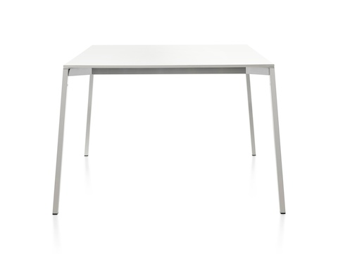 A square Magis Table_One table with a white top and polished aluminum legs.