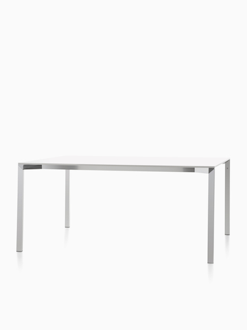 Una mesa rectangular Magis Table_One con una parte superior blanca. Seleccione para ir a la página del producto Magis Table_One.