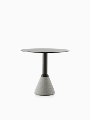 A round Magis Table_One Bistro table with a black top.