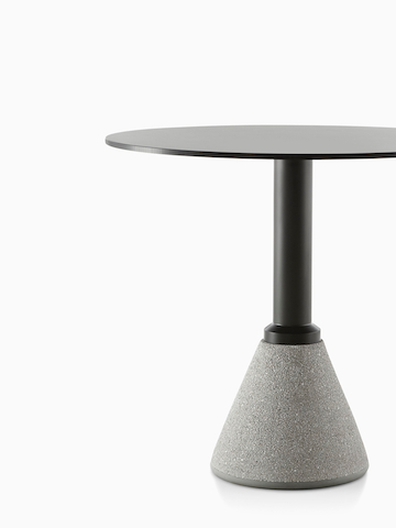 A round Magis Table_One Bistro table with a black top. Select to go to the Magis Table_One Bistro product page.