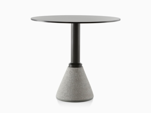 A black Magis Table_One Bistro outdoor table with a round top and concrete base.