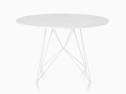 A round Magis Tavolo XZ3 Table with a white top and steel rod base.