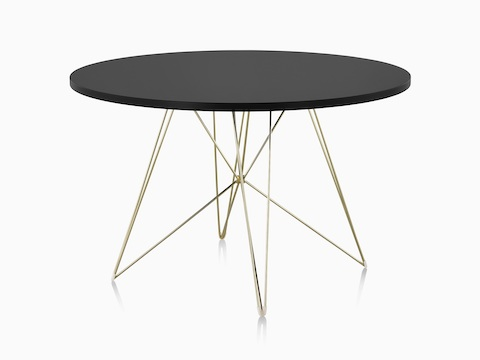 A round Magis Tavolo XZ3 Table with a black top and steel rod base.
