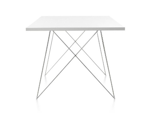 A rectangular Magis Tavolo XZ3 Table with a white top and steel rod base, viewed from the narrow end.