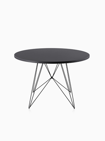A round Magis Tavolo XZ3 Table with a black top.