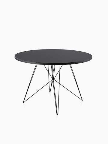 A round Magis Tavolo XZ3 Table with a black top. Select to go to the Magis Tavolo XZ3 product page.