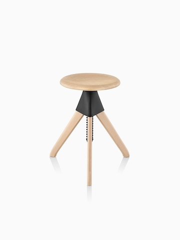 Low Magis Tom and Jerry Stool crafted of solid beech, with a light finish and black joint between the seat and legs.
