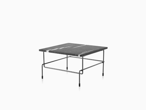 Magis Traffic table with black and gray marbled top, viewed from the front at an angle.