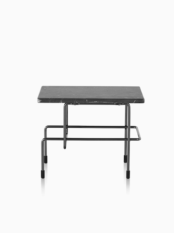A rectangular Magis Traffic table with a black top.