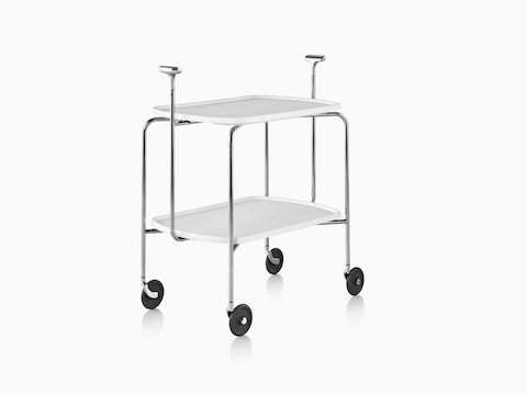 Angled view of a Magis Transit Folding Trolley cart with two white shelves, a steel frame, polished aluminum handles, and casters.