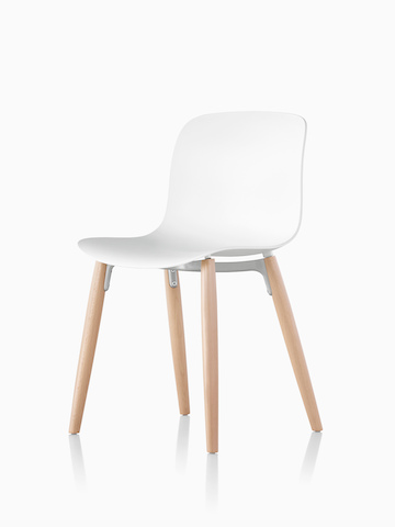 A Magis Troy Plastic Chair with a plastic seat and back and wood legs.