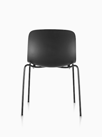 A Magis Troy Plastic Chair with a plastic seat and back and metal frame, viewed from the back.