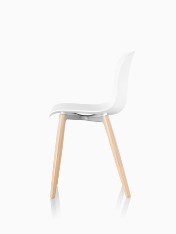 Profile view of a Magis Troy Plastic Chair with plastic seat and back and wood legs.