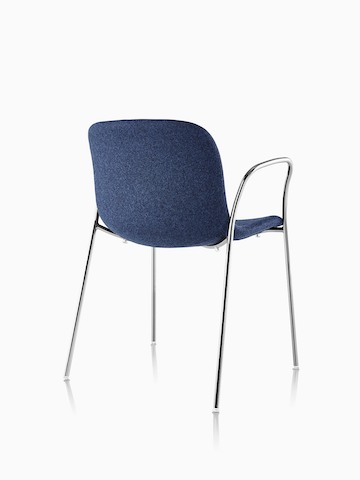 Three-quarter rear view of a blue Magis Troy Upholstered side chair.