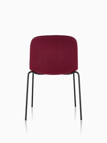 Armless Magis Troy Upholstered side chair in red fabric, viewed from the rear.