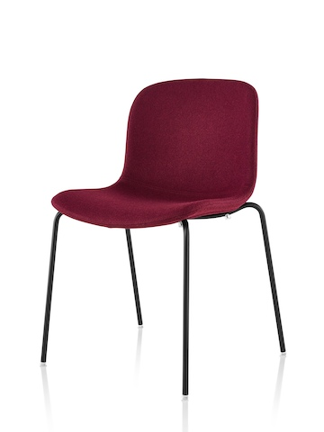 Armless Magis Troy Upholstered side chair in red fabric, viewed from a 45-degree angle.