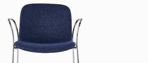 Upper half of a blue Magis Troy Upholstered side chair, viewed from the front.