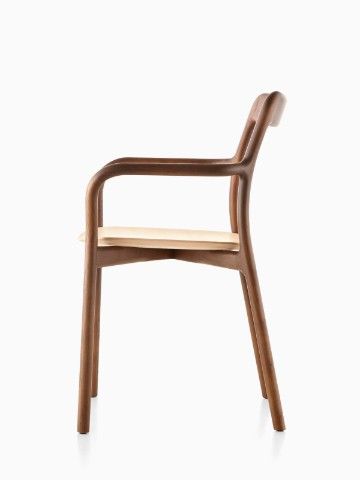 Profile view of a stackable Mattiazzi Branca side chair with a medium wood finish.