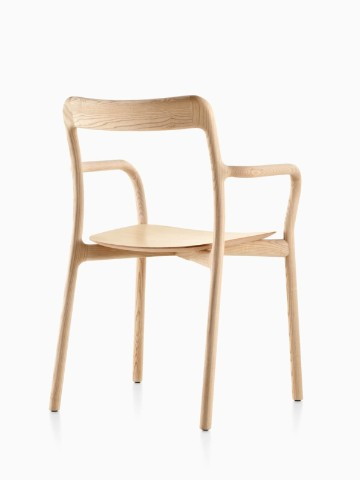 Three-quarter rear view of a stackable Mattiazzi Branca side chair with a light wood finish.