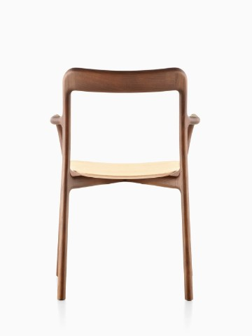 Stackable Mattiazzi Branca side chair with a medium wood finish, viewed from the rear.