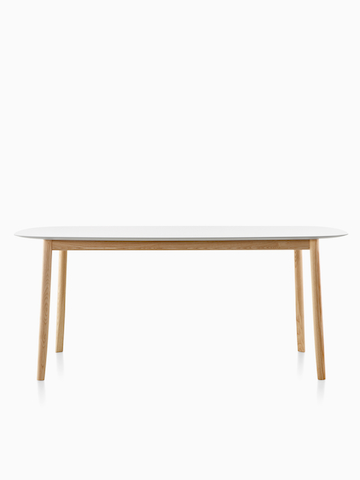 An oval Mattiazzi Branca Table with a white top.