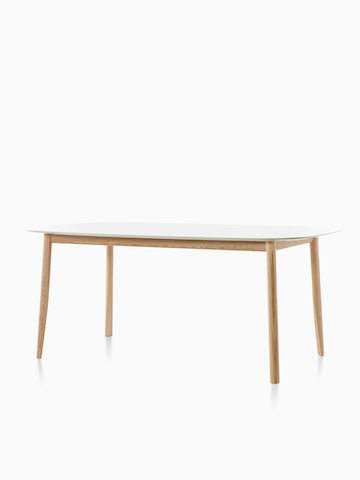 An oval Mattiazzi Branca Table with a white top. Select to go to the Mattiazzi Branca Table product page.
