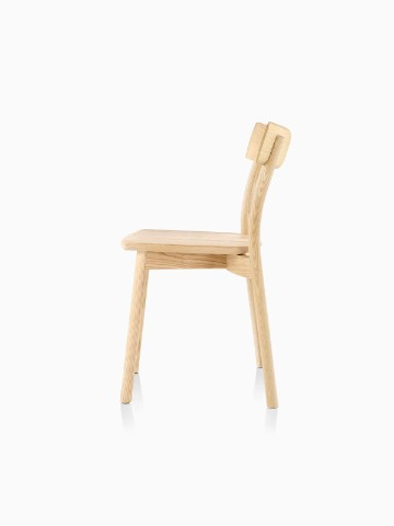 Profile view of an armless Mattiazzi Chiaro stackable side chair with a light wood finish.