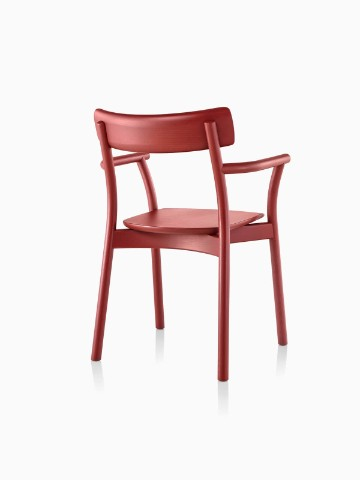Three-quarter rear view of a red Mattiazzi Chiaro stackable side chair.
