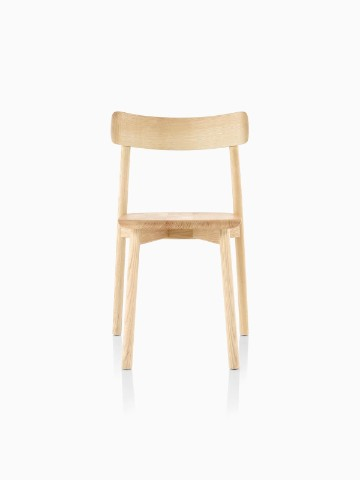 Armless Mattiazzi Chiaro stackable side chair with a light wood finish, viewed from the front.