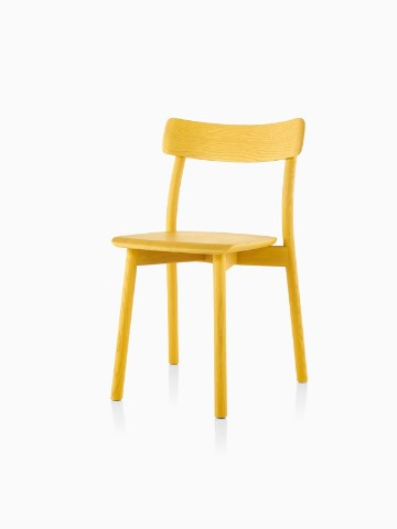 Armless Mattiazzi Chiaro stackable side chair with a yellow finish, viewed from a 45-degree angle.