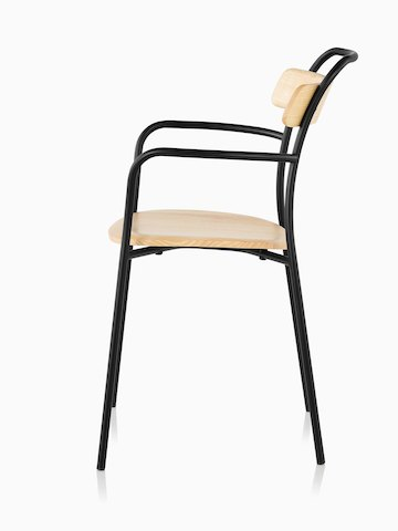 A Mattiazzi Forcina Chair with arms, a black stainless steel frame, and a natural ash seat and back. Viewed from the side.