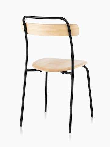 A Mattiazzi Forcina Chair with a black stainless steel frame and a natural ash seat and back. Viewed from behind.