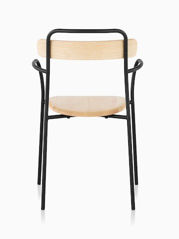 A Mattiazzi Forcina Chair with arms, a black stainless steel frame, and a natural ash seat and back. Viewed from behind.