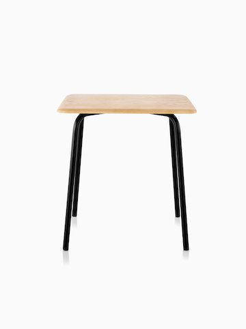 A square Mattiazzi Forcina Table with a black stainless steel frame and a natural ash top.