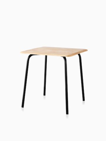 A square Mattiazzi Forcina Table with a black stainless steel frame and a natural ash top. Select to go to the Mattiazzi Forcina Tables product page.