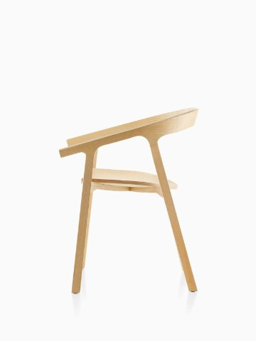 Profile view of a wood Mattiazzi He Said stackable side chair with a light finish.