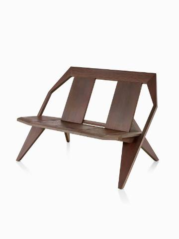 An angled view of a wood Mattiazzi Medici two-seat outdoor bench in a dark finish.